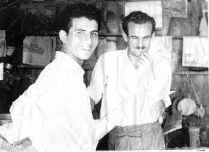 Taha and Samih al-Qasim, in Taha's shop in the mid-50s