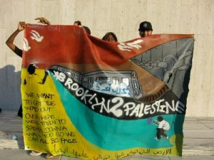 Students participating in the Palestine Education Project (PEP) program in Brooklynholding up their latest creation, 2008