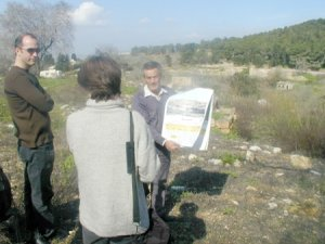 Internally displaced from Safuriya , Abu Arab holds a pre-1948 photo of his toen with the JNF forest that has erplaced in the Background