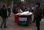 """Ambulance""; Body of starved man carried on pushcart in al-Yarmouk. 29 January 2014 (Source: WorldBulletin.net)"