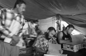 Palestinian prisoners writing their Tawjihi science exams in Ofer military prison, 2004.